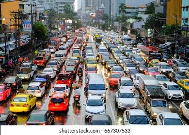 Bangkok-Thailand JUN 20 2017: Traffic jams of Asoke-Sukhumvit Intersection, while rain in the evenings after work.