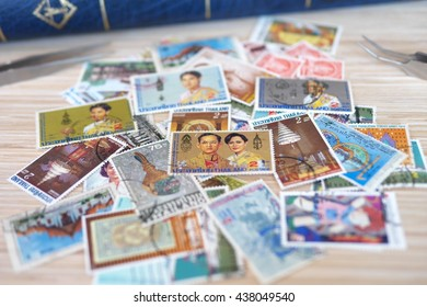 BANGKOK/THAILAND - JUNE 16, 2016 - Mixed collections of postage stamps on wooden desk. It has been suggested that John Bourke, Receiver General of Stamp Dues in Ireland was the first stamp collector.