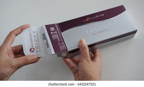 Bangkok,Thailand- June 24 ,2019   :  Filler Product of  Juvederm Voluma brand ,Hand Holding Juvederm  Box