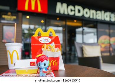 BANGKOK,THAILAND - JUNE 25,2018 : Rainbow dash, character cartoon from my little pony with Happy meal set on desk ,in soft focus, at McDonald's restaurant
