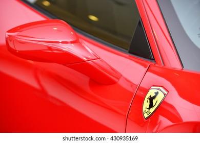 Bangkok,Thailand - JUNE1, 2016 : Logo of ferrari on the sport car.Italian week 2016 at Central World Shopping Mall. Ferrari S.P.A. is an Italian luxury sports car manufacturer. Founded by Enzo Ferrari