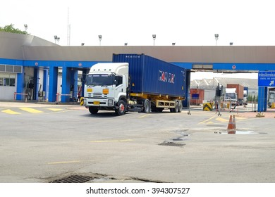 Bangkok-Thailand Mar 20 2016: Trailer trucks are leaving the port to transport goods to the destination.