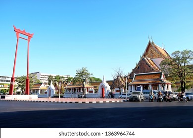 Bangkok/Thailand - March 11,2019 : The iconic Giant Swing (Sao Ching Cha) red religious structure and  beautiful buddhist temple WAT SUTAHAT, at Bangkok old town - famous Thailand tourism attractions.