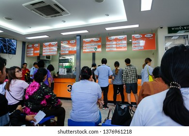 Bangkok,Thailand - March 15, 2019: Commuters wait to board transport vans near Mo Chit BTS station . Mo Chit Bus Terminal, The Bus Terminal Mochit is the largest in the bangkok Thailand