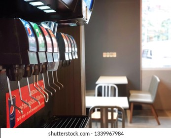 Bangkok,Thailand - March 16,2019 : Pepsi' s soft drink dispenser at  KFCdrive thru Ramintra 83 Branch .There are many brands of sparkling water.large soda