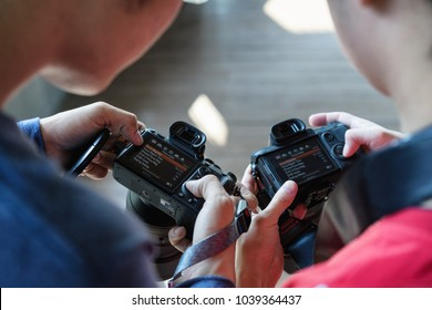 BANGKOK,THAILAND - MARCH 1st,2018: Two asian photograper are setting camera Sony model A7R3 together for take a shot activity. Sony model A7Riii is newest model camera for photography.