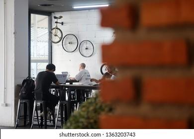 Bangkok/Thailand - March 21,2019: People working with his laptop at the shopping mall co-working space area.