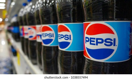 BANGKOK/THAILAND -MARCH 2nd 2018 :Bottle of Pepsi cola on shelf at Lotus mall, Pepsi is a carbonated soft drink produced PepsiCo. Created in 1893