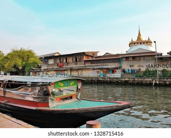 Bangkok,Thailand - March 4,2019 : Longtail boat in khlong saen saep is one of transport in bangkok.The Saen Saep Canal passenger ship stops at Panfa Leelard Pier can saws The Golden Mount.