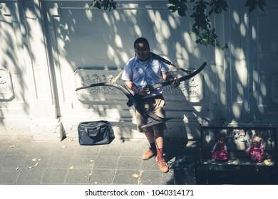 Bangkok,THAILAND - March 7, 2018.Thai students play music using native instruments to earn money at leisure. Bangkok, Thailand.