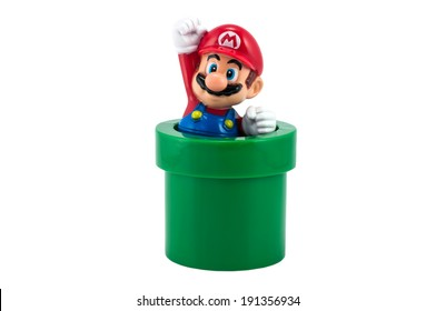 Bangkok,Thailand - May 01,2014: Super Mario with pipe toy figure. There are plastic toy sold as part of the McDonald's Happy meals.