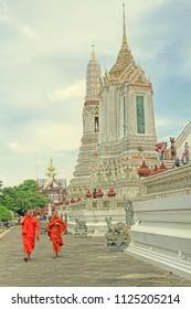 BANGKOK,THAILAND - May 07, 2018: traditional dressed monks  in Wat Arun Ratchatharam or Temple of the Dawn, Bangkok, Thailand