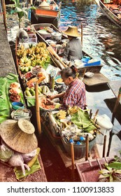 BANGKOK,THAILAND - May 08, 2018: traditional vendors on the famous floating market Damnoen Saduak in Bangkok. It is a traditional market on the khlongs, where they sell goods and food from the boats.