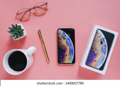 BANGKOK,THAILAND - May 17,2019: Flat lay of workspace desk with new Apple iPhone XS. Instagram is a photo-sharing app for smartphones. Brand new smartphone from Apple