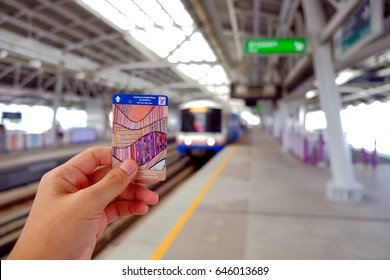 Bangkok-Thailand MAY 20 2017: Left hand man show BTS One-Day Pass Ticket on BTS station background, BTS One-Day Pass is a travel ticket, available all day until midnight.