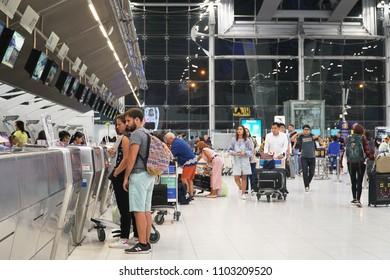 BANGKOK,THAILAND -MAY 20 -2018: The passengers waiting in a row queue with luggage for check in at the Suvarnabhumi Airport terminal.Bangkok.
