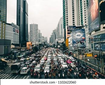 Bangkok,Thailand May 31,2018: Traffic jam at Asoke Intersection. Bangkok's traffic is usually busy during the rush hour.