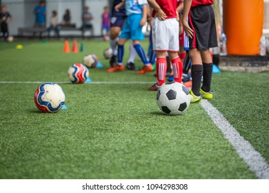 Bangkok,Thailand - MAY 9th, 2018: Soccer ball tactics on grass field with cone for training thailand in  background Training children in Soccer academy