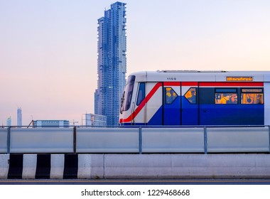 Bangkok-Thailand NOV 12 2018: BTS SkyTrain on cityscape background on evening time and afterwork, BTS SkyTrain is a mass transit system in Bangkok to help facilitate and speed the journey.