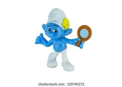 Bangkok,Thailand - November 10, 2014: Vanity smurf and a mirror in hand character from The Smurf movie.  There are plastic toy sold as part of the McDonald's Happy meals.