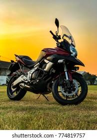 Bangkok,Thailand - November 13,2017: Motorcycle Kawasaki Versys 650cc Park in the lawn in the evening.