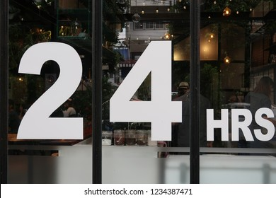 Bangkok/Thailand - November 17,2018 : 24 hours sign on the glass window of an all night service cafe.