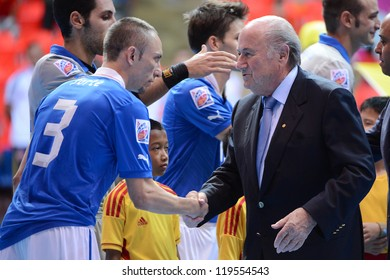 BANGKOK,THAILAND -NOVEMBER 18: FIFA President Joseph S. Blatter shakes hands with players of Italy prior to the FIFA Futsal World Cup 3rd/4th match at Indoor Stadium Huamark on Nov18,2012 in,Thailand.