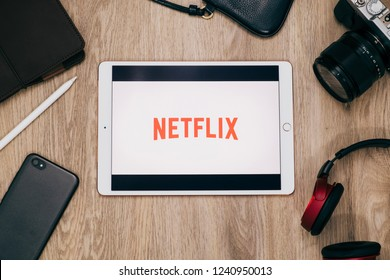 BANGKOK,THAILAND - NOVEMBER 21,2018 :iPad pro on wooden desk open Netflix application with media accessories.