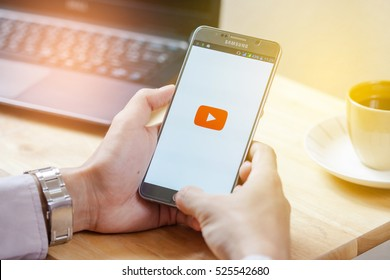 BANGKOK,THAILAND -November 28,2016:Smartphone with YouTube app on the screen YouTube is the popular online video-sharing website, founded in February 14, 2005