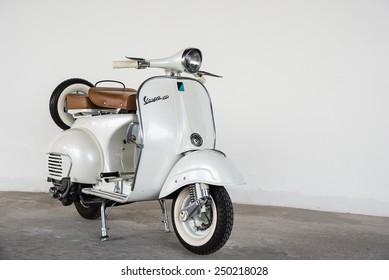 Bangkok,THAILAND - November 30 : 1964 vintage  white Vespa Italian designed scooter is parking in building at November 30, 2014 in Bangkok,Thailand