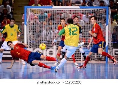 BANGKOK,THAILAND - NOVEMBER18:Falcao (no.12)of Brazil shoot the ball during the FIFA Futsal World Cup Final between Spain and Brazil at Indoor Stadium Huamark on Nov18, 2012 in ,Thailand.