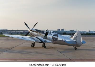 "Bangkok,Thailand - October 28, 2019. Hi resoluation image of Supermarine Spitfire Mk.IX G-IRTY (MJ271) or ""The Silver Spitfire"" parked at Donmueang International Airport."