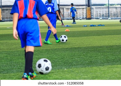 Bangkok,Thailand - October 28th, 2016: Soccer ball tactics on grass field with cone for training thailand in  background Training children in Soccer academy