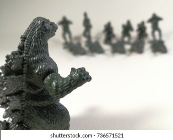 Bangkok,Thailand - October 3, 2017: The photo collection of Godzilla King of the Monsters figure toy versus American military in green plastic model. Godzilla is a giant monster or daikaiju.