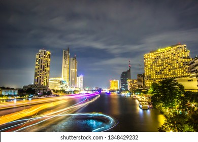 Bangkok,Thailand on December10,2018:Beautiful scene of Chao Phraya River with luxury Hotels on the riverbanks and colorful lights at night.