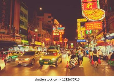Bangkok,Thailand - Sep 25, 2018 : Street of Yaowarat at nighttime with many cars and tourists walking in Bangkok,Thailand on September 25, 2018. Chinatown is famous landmark in Bangkok.