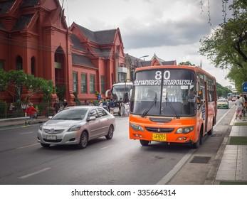 BANGKOK,THAILAND SEP 29: Mini bus number 80 stop opposite Thawon watthu or red building Sanam Luang under dark raincloud, on SEPTEMBER 29, 2015 in Bangkok, Thailand.