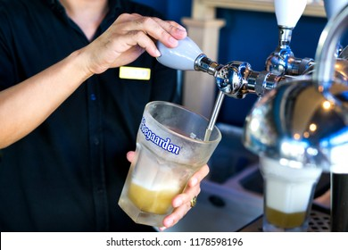 BANGKOK,THAILAND. September 12,2018: Hoegaarden draft Belgium beer in large size glass on counter bar in pub was taken in Bangkok,Thailand.