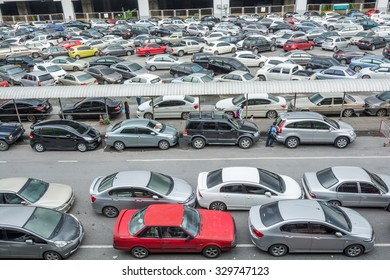 Bangkok,Thailand - September 28, 2015 : Cars parked at a parking lot at a BTS station in Chatuchak district in Bangkok,Thailand.The government has promoted park and ride to reduce traffic congestion.