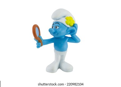Bangkok,Thailand - September 29, 2014: Vanity smurf and a mirror in hand character from The Smurf movie.  There are plastic toy sold as part of the McDonald's Happy meals.