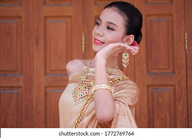 Bangkok,Thailand - September,2017:Thai smiley teenage with Thai Rattanakosin Dress, meticulously designed, Prepare to perform Thai classical dance.