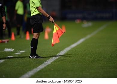 Bangkok-Thailand-13Jul2019:Flag of assistant referee during thaileague match between port fc against chonburi fc at pat stadium,thailand