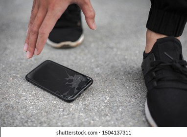 Bangkok,Thailand-14thSeptember,2019:Turn off the phone of the iPhone 7 male model. The apple brand fell on the floor and the hand of the man to answer the phone.