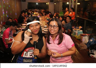 Bangkok,Thailand,21 Dec 2017,Office employees celebrate the new year party by wearing a sports dress contest. Join the singing and give away prizes in the karaoke room with beautiful lighting.