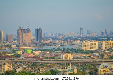 Bangkok/Thailand-25 December 2017:     Bangkok skyscrapers on the riverside of Chao Phraya river