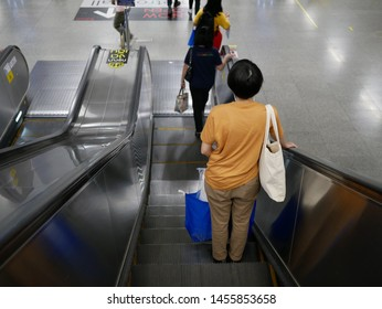 BANGKOK,THAILAND-5 JULY 2019:Passengers use escalators at MRT Purple Line MRT Station.