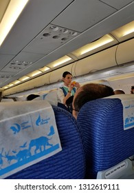 Bangkok,Thailand-8 February 2019: Flight attendant of Bangkok Airways demonstrates an inflight safety briefing  on how to use the oxygen mask on board before taking off.