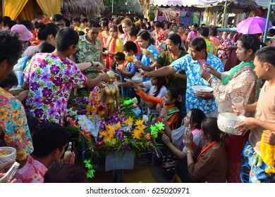 BANGKOK,THAILAND-APRIL 16,2017:  Songkran Festival in the Thai-Mon style, at Bangkradi Temple, bangkuntien, water pouring to Buddha statue in Songkran festival tradition of Thai-Mon style