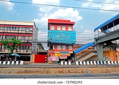 BANGKOK-THAILAND-APRIL 19 : The commercial building near the road in the city, April 19, 2016 Bangkok, Thailand