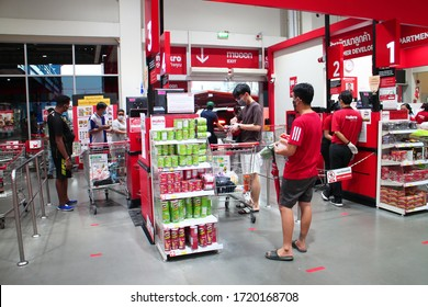 Bangkok/Thailand-April 25 2020: Checking out area at Makro supermarket. People wearing face mask buying. Panic shopping during Coronavirus covid-19 pandemic.